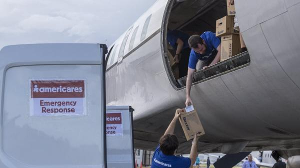 Baxter-donated products arriving in Puerto Rico with Americares Emergency Response Flight. Photo Credit: Alejandro Granadillo/Americares.